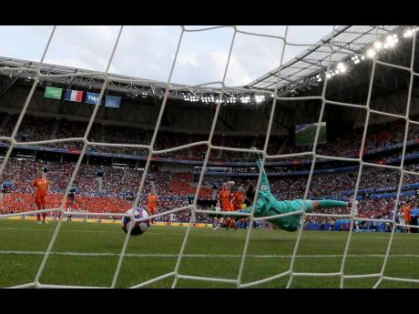 Netherlands goalkeeper Sari Van Veenendaal fails to save a shot by United States' Rose Lavelle (not pictured), who scored her side's second goal during the FIFA Women's World Cup final at the Stade de Lyon in Decines, outside Lyon, France, yesterday.