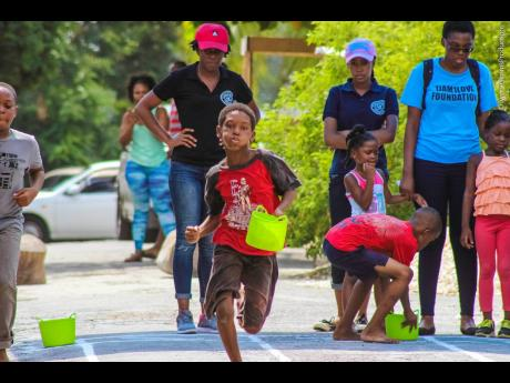 Children participate in 'Track on Streets' during last year's staging in Allman Town, Kingston.