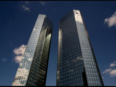 Clouds reflected in the facade of the headquarters of Deutsche Bank in Frankfurt, Germany, on Monday, July 8, 2019.