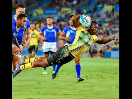 Contributed Jamaica Crocs' Reinhardo 'Rhino' Richards scoring Jamaica's lone try against Samoa in Commonwealth Games Rugby Sevens action on the Gold Coast, Australia on Saturday April 14, 2018.