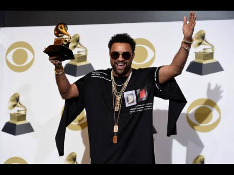 Shaggy poses in the press room with the award for Best Reggae Album for '44/876' at the 61st annual Grammy Awards at the Staples Center on Sunday, February 10, 2019, in Los Angeles.