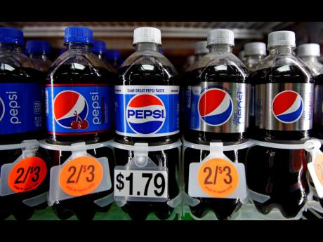 Pepsi soft drink bottles are displayed at a store in Windham, New Hampshire.