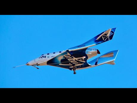 In this December 13, 2018 file photo, a view of Virgin Galactic prior to it reaching space for the first time during its fourth powered flight from Mojave, California.