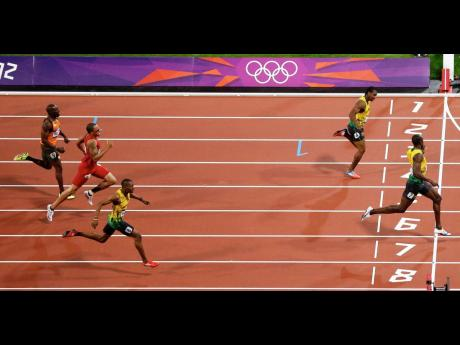 Jamaica's Usain Bolt crosses the finish line to win the gold medal in the men's 200m final at the London 2012 Summer Olympics during the heights of Jamaica's sprint dominance. Countrymen Yohan Blake (second) and Warren Weir (third) round out the medals in an impressive 1-2-3 finish for the country.
