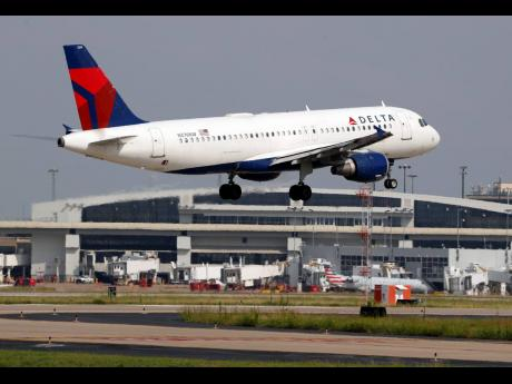 AP  A Delta Air Lines aircraft makes its approach at Dallas-Fort Worth International Airport in Grapevine, Texas.