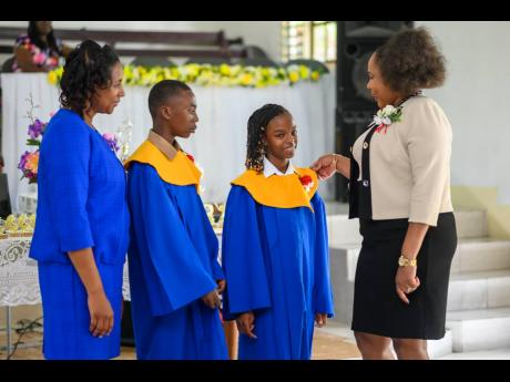 Winsome McNish Ricketts, business relationship and sales manager, JN Bank, Ocho Rios and Port Maria, with graduates of the Gayle Primary School in St Mary before sharing words of encouragement with the cohort at their school-leaving ceremony held recently.