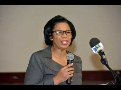 Acting Deputy Chief Nursing Officer in the Ministry of Health and Wellness, Saidie Williams-Allen, speaks at the Nurse Practitioners 66th National Seminar at the Royalton White Sands in Trelawny on Wednesday.