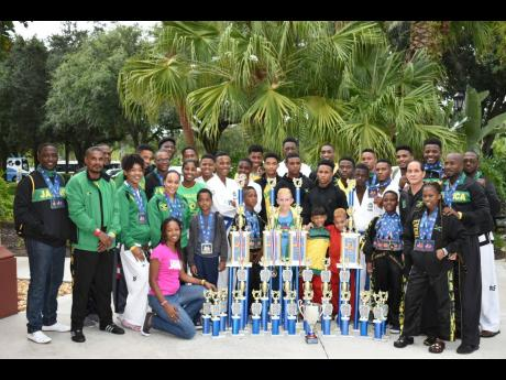Jamaica's female quartet at last week's International Sports Karate Association United States Open World Championships (front row), starting third left), Aneeke Brown, Jasmine Barrows, Karyll Bennett-Robinson, and Marissa Brown, right, front row, pose with team-mates, showing off their 54-medal haul of 19 gold, 15 silver and 20 bronze.