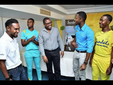(From left) Sandals Resorts Public Relations Manager – Sponsorships Crissano Dalley; Western Heat player Matthew Comrie; JCA CEO Courtney Francis; corporate sales manager at Rainforest Seafoods; Richard Coleman and Northern Lights player Romaine Bennett share a laugh at the launch of the 2019 Sandals U-19 Cricket Championships.