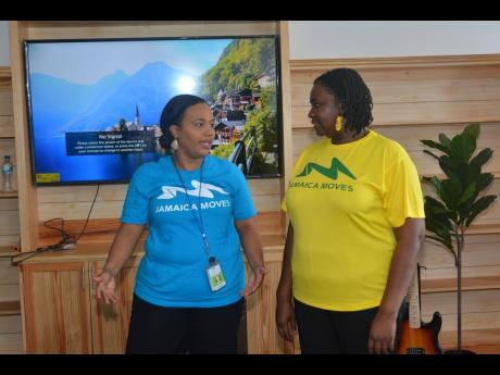 Regional health promotion and education officer at the Western Regional Health Authority (WRHA), Marcelene Wheatle (right), converses with human resource manager at 24-7 Intouch, Ann-Marie Green (left), during the launch of the company's corporate wellness programme at its office in Freeport, Montego Bay, St James, on July 3.