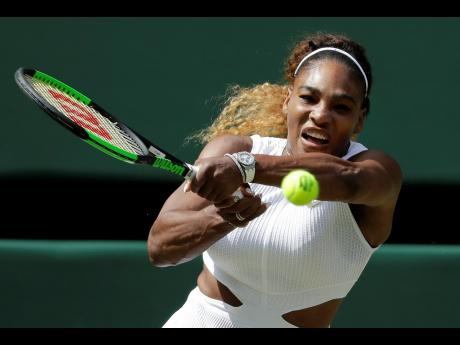 United States' Serena Williams returns to Czech Republic's Barbora Strycova in a women's semi-final singles match on Day 10 of the Wimbledon Tennis Championships in London, England, yesterday.