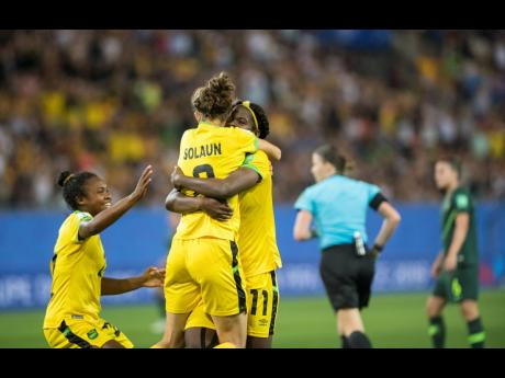 Reggae Girl Havana Solaun (front, centre) celebrates her goal scored at the FIFA Women's World Cup against Australia, with teammates Mireya Grey (left) and Khadija Shaw, on Tuesday, June 18.