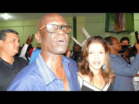 Desmond McKenzie (centre), member of parliament for West Kingston, Andrew Seaga and Annabelle Seaga at recent 'Revival Table' held in memory of former prime minister, Edward Seaga, inside the Tivoli Gardens Community Centre, recently.