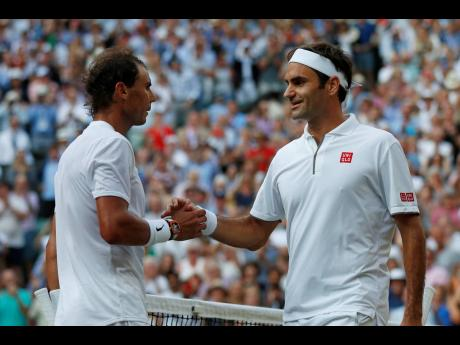 Switzerland's Roger Federer (right) greets Spain's Rafael Nadal after the match.