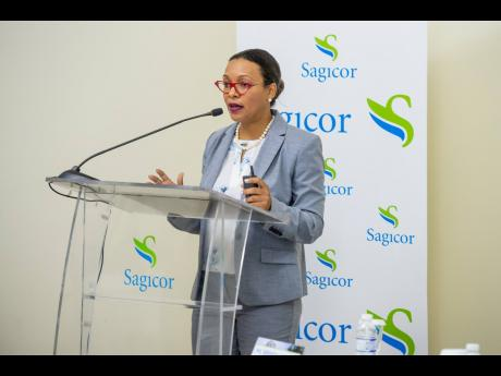 Sagicor Real Estate X Fund CEO Brenda Lee Martin addresses the company's annual general meeting on Wednesday, July 10 at the Jewel Grande Hotel in Montego Bay.