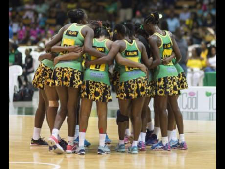 Members of Jamaica's national senior netball team, the Sunshine Girls, huddle during the Sunshine Series against England Netball at the National Indoor Sports Centre in Kingston on Saturday, October 13, 2018.