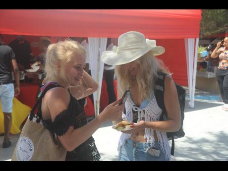 Swedish reggae fan Amanda Elfstrand (left) and her companion enjoying the ambience at Mawnin Medz.