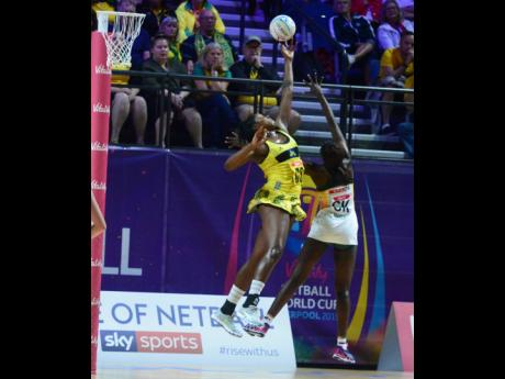 Jamaica captain Jhaniele Fowler (left) goes high for a lob pass over South Africa goalkeeper Phumza Maweni as the Sunshine Girls lose their first match of the 2019 Vitality Netball World Cup at the M&S Bank Arena in Liverpool, England, yesterday.