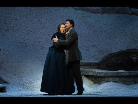 Kristine Opolais and Vittorio Grigolo in The Met Opera's La Bohème.
