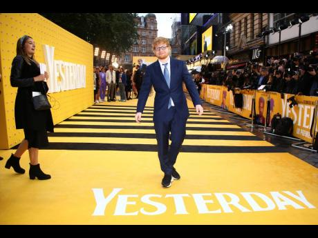 Ed Sheeran poses for photographers upon arrival at the premiere of the film 'Yesterday' in London, last month.