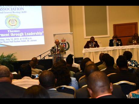Police Commissioner Major General Antony Anderson addressing senior members of the Jamaica Constabulary Force at the annual general meeting of the Police Officers' Association at the Iberostar Rose Hall Hotel in St James on July 12.