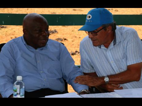 Chairman of the Jamaica Red Poll Society, Martin Hopwood (right), chats with Dr Al Powell, CEO of Agro-Invest Corporation, during yesterday's joint annual meeting of the Jamaica Brahman, Jamaica Black and Jamaica Cattle Breeders Society, at Minard Estate in Brown's Town, St Ann.