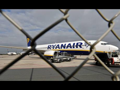 In this September 12, 2018 file photo, a Ryanair plane is parked at the airport in Weeze, Germany.