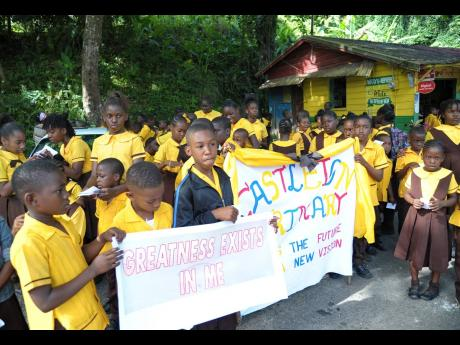 Students of Castleton Primary School march through their community recently.