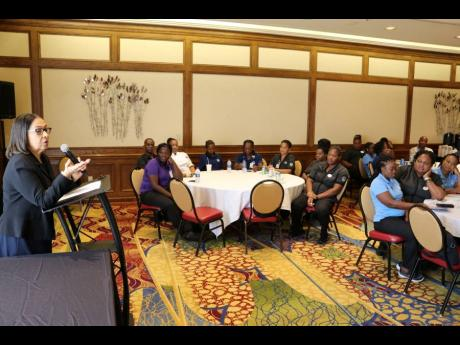 Minister of Labour and Social Security Shahine Robinson addresses Jamaican hotel workers at the Grand Traverse Hotel in Traverse City, Michigan, in the United States earlier this week.
