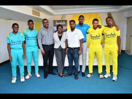From left: Western Heat players Matthew Bell and Mathew Comerie; Jamaica Cricket Association (JCA) Chief Executive Officer Courtney Francis; JCA Director Pauline White-Anderson; Sandals Resorts Public Relations Manager – Sponsorships, Crissano Dalley; Corporate Sales Manager at Rainforest Seafoods, Richard Coleman; and Northern Lights players Junior Coleman and Romaine Bennett at the launch of the 2019 Sandals Under-19 Cricket Championships at Sabina Park in Kingston on June 25.