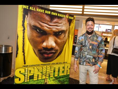 Writer and director, Storm Saulter, poses alongside a banner of SPRINTER while at the film's US premiere at the Grove Theater in Los Angeles, California, in April 23. 'Sprinter' opened locally on Wednesday, July 3.