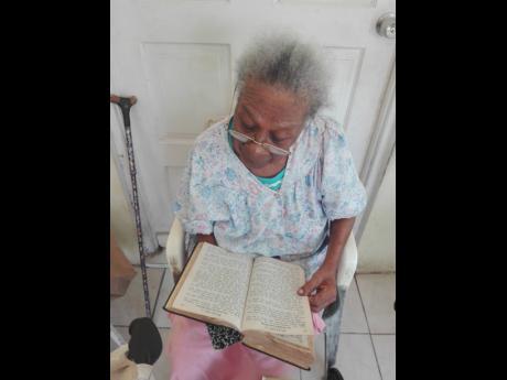 Sylvia 'Mama Liz' Paisley reads her Bible.