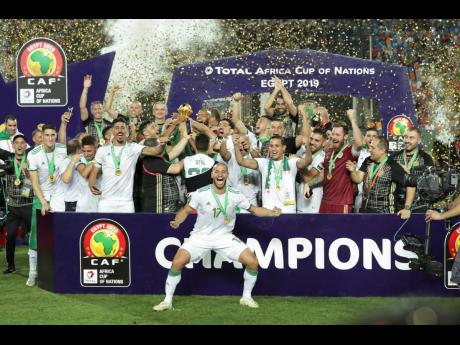 Algerian players celebrate after winning the African Cup of Nations at the Cairo International Stadium in Cairo, Egypt, yesterday.