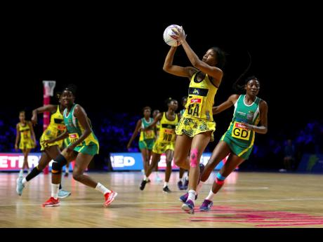 Jamaica's Rebekah Robinson (second left) takes possession of the ball while Zimbabwe goal defence Felisitus Kwangwa (right) tracks back, and Adelaide Muskwe (left) looks on during their Vitality Netball World Cup match at the M&S Bank Arena in Liverpool, England, yesterday.