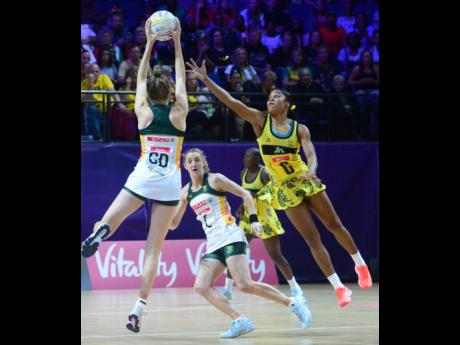 Jamaica's Adean Thomas (right) challenges for the ball as South Africa's Karla Pretorius (GD) tries to pass it to her teammate, Erin Burger (C) during the 2019 Vitality Netball World Cup in Liverpool, England recently.