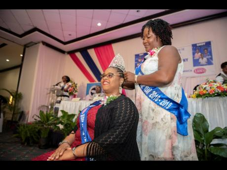 Keisha Riley-Harrow is crowned the 2019-2020 Nurse of the Year by outgoing Nurse of the Year Denese Dacres-Reeves at the Nurses' Association of Jamaica and LASCO National Nurse of the Year Awards held at The Jamaica Pegasus hotel in New Kingston yesterday.