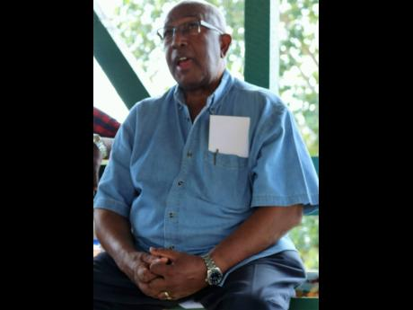 Manager Corporate Affairs with the Caribbean Broilers Group, Dr Keith Amiel, addresses the joint annual meeting of the Jamaica Red Poll, Jamaica Black Poll and Jamaica Brahman Breeders Society from the floor on Wednesday at the Minard Estate in Brown's Town, St Ann.
