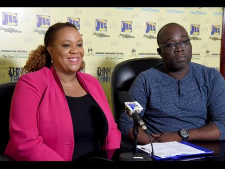 Citizen Security and Justice Programme III communications/social marketing specialist, Patrice Tomlinson-Nephew, speaks about the youth summer camps being funded by the programme, during a recent JIS Think Tank. Listening is Sergeant Alexander Bloomfield of the St Andrew South Police Division.