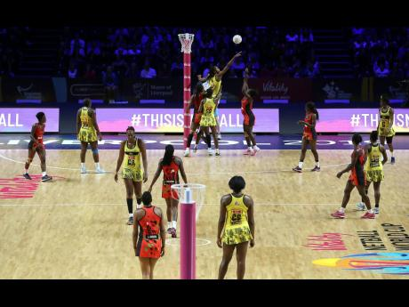 Action from the Vitality Netball World Cup fifth place match between Jamaica and Malawi at the M&S Bank Arena, in Liverpool, England yesterday.