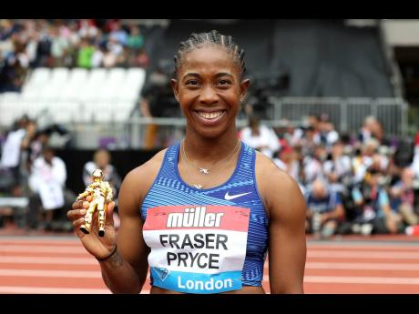 Jamaica's Shelly-Ann Fraser-Pryce is all smiles after taking gold in the Women's 100m final during day two of the IAAF London Diamond League meet at the London Stadium in London, England, yesterday.