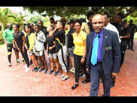 Jamaica Olympic Association president Christopher Samuda (right) posing with some of the members of Jamaica's team to the 2019 Pan Am Games, which will be held in Lima, Peru, from July 26-August 11, 2019.