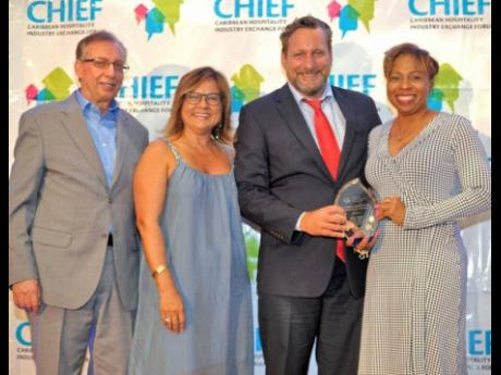 Wyb Meijer (second from right) is the 2019 Caribbean Association Executive of the Year. From left are Frank Comito, CHTA director general and CEO; Patricia Affonso-Dass, CHTA president; and Stacy Cox, president of the Caribbean Society of Hotel Association Executives.