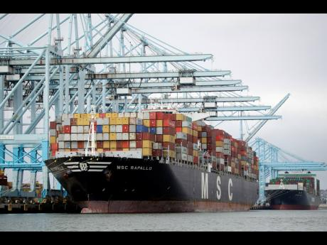 A cargo ship is docked at the Port of Los Angeles, in Los Angeles, California.  AP