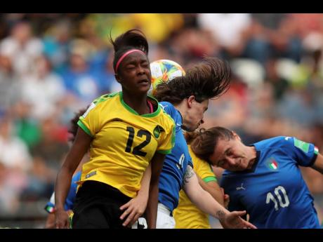 Jamaica's Sashana Campbell (left) jumps for the ball with Italy's Daniela Sabatino (centre) and Cristiana Girelli during their countries' Women's World Cup Group C match at the Stade Auguste-Delaune in Reims, on France, on Friday, June 14.