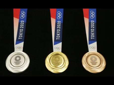 Tokyo 2020 Olympic medals are unveiled during a One Year to Go Olympic ceremony event in Tokyo yesterday.