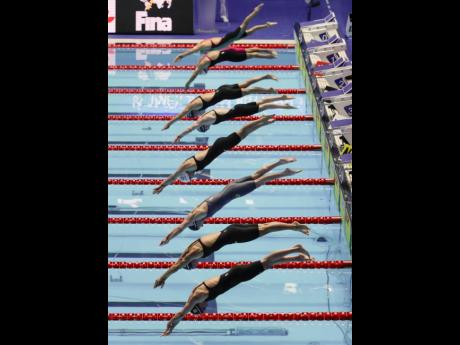 Swimmers start in the women's 200m butterfly semi-final at the World Swimming Championships in Gwangju, South Korea, yesterday.