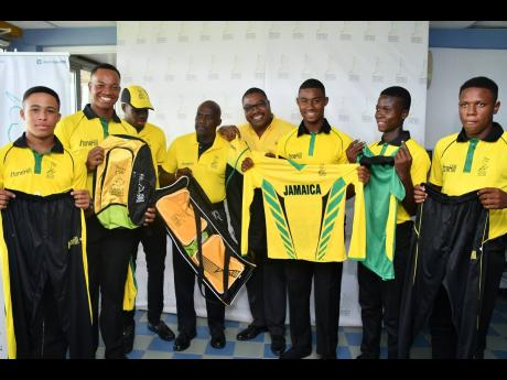 (From left) Danielle Beckford, Tian Jarrett, skipper Kirk McKenzie, manager Gibbs Williams, CEO Courtney Francis, Matthew Comerie, reserve player Andrew Hunter, and Andre Morgan pose with the warm-up and playing kits received at Tuesday's press conference and motivational session used to announce Jamaica's Under-19 team to the CWI Regional Championships team at Sabina Park.
