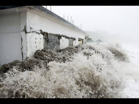 Ferocious waves crash violently against an abandoned house in Caribbean Terrace in St Andrew as Hurricane Sandy approached the island in October 2012.