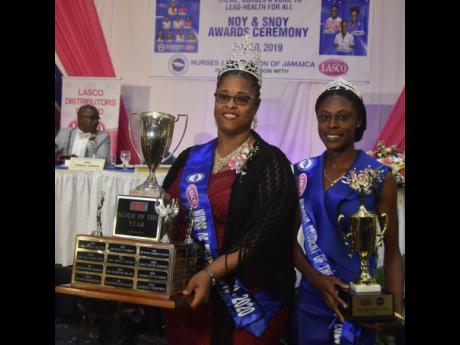 Newly crowned LASCO/Nurses Association of Jamaica (NAJ) Nurse of the Year 2019-2020 Keisha Riley-Harrow (left) shares the spotlight with Nursing Student of the Year Tacquise Campbell during the awards ceremony at The Jamaica Pegasus hotel on Saturday, July 20, 2019.