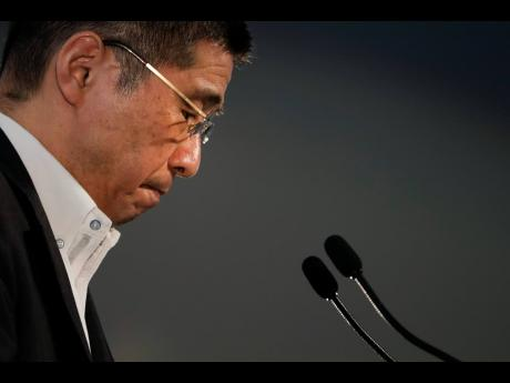 Nissan CEO Hiroto Saikawa pauses for a moment during a news conference at the global headquarters on Thursday, July 25, in Yokohama, west of Tokyo.